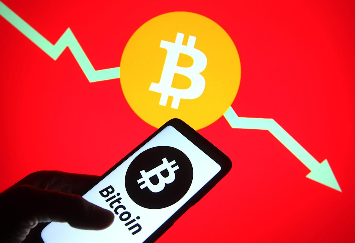 UKRAINE - 2021/05/23: In this photo illustration a Bitcoin (BTC) cryptocurrency logo is seen on a smartphone and a pc screen. (Photo Illustration by Pavlo Gonchar/SOPA Images/LightRocket via Getty Images)
