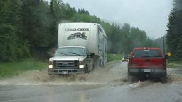 Rising waters flooded Highway 3 east of Sparwood, B.C., in May 2020.