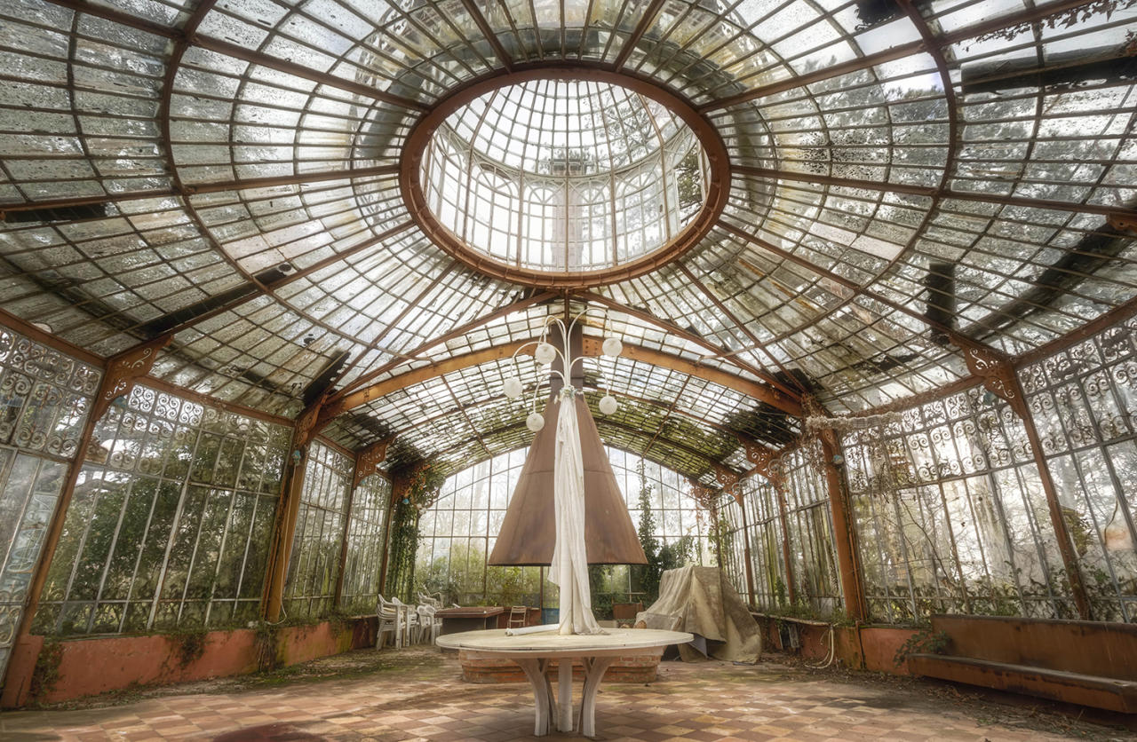 <p>A photographer has released a stunning collection of abandoned buildings that are still standing despite years of neglect. (Photo: Roman Robroek/Caters News) </p>