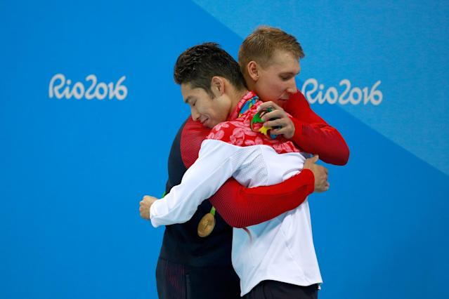 <p>(L-R) Silver medalist Chase Kalisz of the United States and gold medal medalist Kosuke Hagino of Japan embrace during the medal ceremony for the Final of the Men's 400m Individual Medley on Day 1 of the Rio 2016 Olympic Games at the Olympic Aquatics Stadium on August 6, 2016 in Rio de Janeiro, Brazil. (Photo by Adam Pretty/Getty Images) </p>