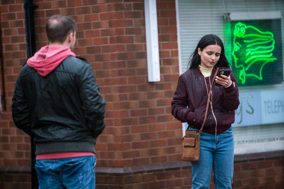 FROM ITV  STRICT EMBARGO - No Use Before  Tuesday 2nd March 2021  Coronation Street - Ep 10269  Wednesday 10th March 2021 - 1st Ep  After finding out her family dog back in Romania has died, Alina Pop [RUXANDRA POROJNICU] bursts into tears in the street.  Tyrone Dobbs [ALANHALSALL] is sympathetic and tells Alina about his own dog Monica.   Picture contact David.crook@itv.com   Photographer - Danielle Baguley  This photograph is (C) ITV Plc and can only be reproduced for editorial purposes directly in connection with the programme or event mentioned above, or ITV plc. Once made available by ITV plc Picture Desk, this photograph can be reproduced once only up until the transmission [TX] date and no reproduction fee will be charged. Any subsequent usage may incur a fee. This photograph must not be manipulated [excluding basic cropping] in a manner which alters the visual appearance of the person photographed deemed detrimental or inappropriate by ITV plc Picture Desk. This photograph must not be syndicated to any other company, publication or website, or permanently archived, without the express written permission of ITV Picture Desk. Full Terms and conditions are available on  www.itv.com/presscentre/itvpictures/terms
