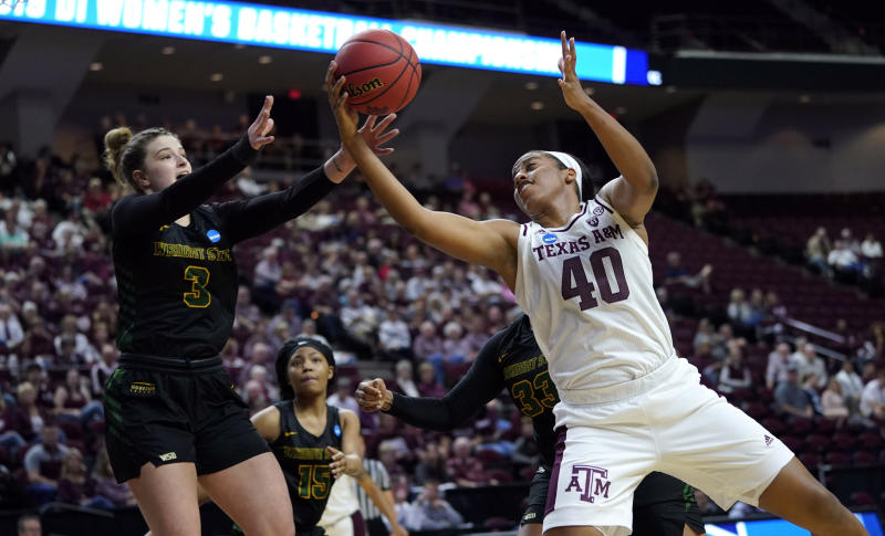 Texas A&M's Ciera Johnson (40) and Wright State's Emily Vogelpohl (3) reach for a rebound during the first half of a first round women's college basketball game in the NCAA Tournament Friday, March 22, 2019, in College Station, Texas. (AP Photo/David J. Phillip)