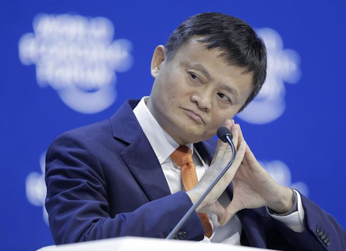 Jack Ma seated in front of a microphone