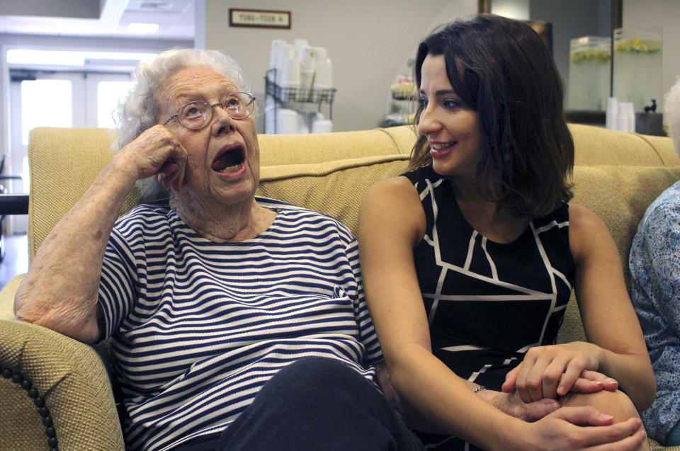 Victoria Kozar, right, of New Milford, Conn., chats with her friend, Beth Eichelman, 91, inside Masonicare at Ashlar Village, a retirement community in Wallingford, Conn. Kozar lived at the center during her senior year at Quinnipiac University as part of an intergenerational learning program. (AP Photo/Pat Eaton-Robb)