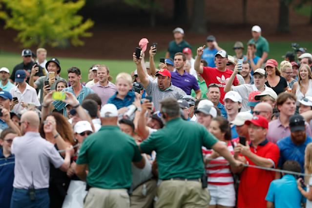 Fans run towards the 18th green to watch Rory McIlroy win the Tour Championship golf tournament and The FedEx Cup Sunday, Aug. 25, 2019, at East Lake Golf Club in Atlanta. (AP Photo/John Bazemore)