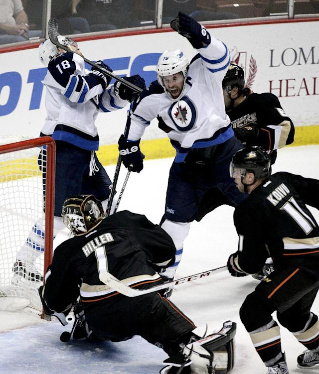 Winnipeg Jets' Andrew Ladd, top right, celebrates a goal by teammate Bryan Little (18) in front of Anaheim Ducks goalie Jonas Hiller, of Switzerland, and Saku Koivu, of Finland, during the first period of an NHL hockey game, Tuesday, Jan. 21, 2014, in Anaheim, Calif. (AP Photo/Jae C. Hong)