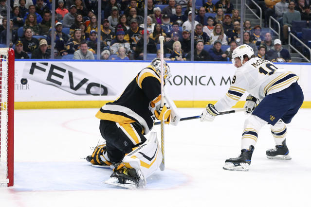 Buffalo Sabres defenseman Jake McCabe (19) puts the puck past Pittsburgh Penguins goalie Matt Murray (30) for a goal during the first period of an NHL hockey game Thursday, March 5, 2020, in Buffalo, N.Y. (AP Photo/Jeffrey T. Barnes)