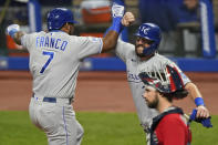 Kansas City Royals' Maikel Franco, left, is congratulated by Cam Gallagher after Franco hit a three-run home run during the seventh inning of a baseball game Thursday, Sept. 10, 2020, in Cleveland. The Royals won 11-1. (AP Photo/Tony Dejak)