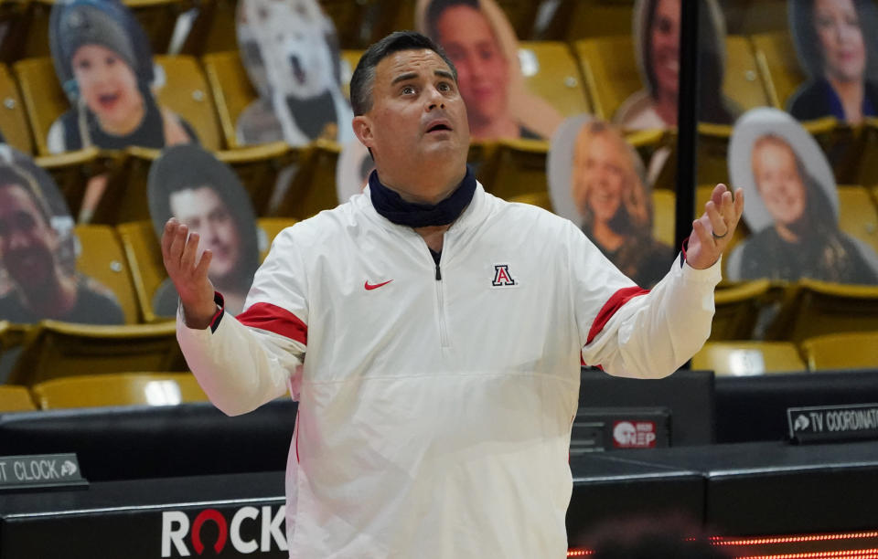 FILE - Arizona coach Sean Miller looks up at the overhead video screen to watch a foul committed by guard Bennedict Mathurin against Colorado forward Evan Battey late in the second half of an NCAA college basketball game in Boulder, Colo., in this Saturday, Feb. 6, 2021, file photo. Arizona has parted ways with men's basketball coach Sean Miller as the program awaits its fate in an NCAA infractions investigation, a person with knowledge of the situation told The Associated Press. The person told the AP on condition of anonymity Wednesday, April 7, 2021, because no official announcement has been made.( (AP Photo/David Zalubowski, File)