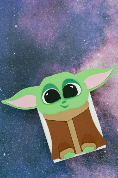 """<p>This pint-size favorite captured hearts in <em>The Mandalorian</em>, and now he'll do the same in your kid's classroom. </p><p><em><a href=""""https://funmoneymom.com/baby-yoda-valentine-box/"""" rel=""""nofollow noopener"""" target=""""_blank"""" data-ylk=""""slk:Get the tutorial at Fun Money Mom »"""" class=""""link rapid-noclick-resp"""">Get the tutorial at Fun Money Mom »</a></em></p>"""