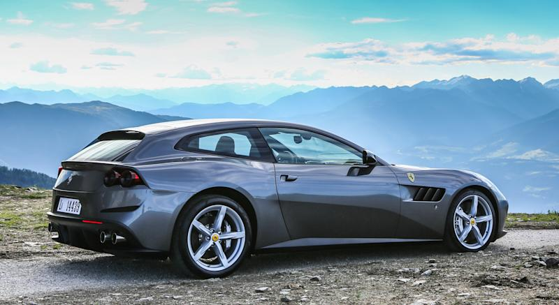 A silver Ferrari GTC4Lusso, a four-passenger luxury-sports car powered by a V12 engine.