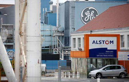 The logos of French power and transport engineering company Alstom and U.S. conglomerate General Electric are pictured on their site in Belfort,  April 27, 2014.  REUTERS/Vincent Kessler