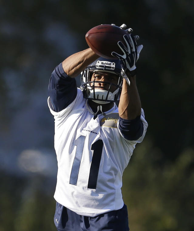 Seattle Seahawks wide receiver Percy Harvin makes a catch as he takes part in an NFL football practice, Tuesday, Oct. 22, 2013, in Renton, Wash. It was Harvin's first full team practice since he injured his hip during the off-season. (AP Photo/Ted S. Warren)