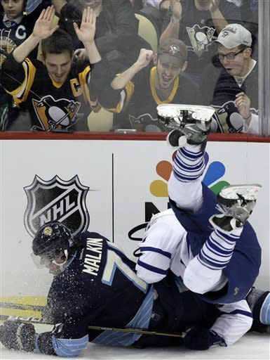 Pittsburgh Penguins' Evgeni Malkin (71) collides with Toronto Maple Leafs' Jake Gardiner in the first period of an NHL hockey game in Pittsburgh on Wednesday, March 7, 2012. (AP Photo/Gene J. Puskar)