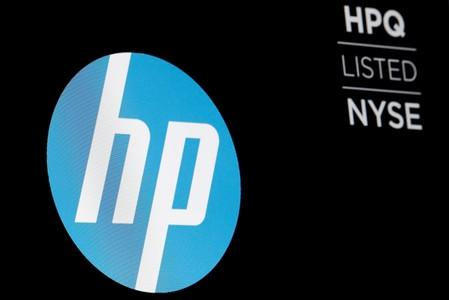 FILE PHOTO: The logo for The Hewlett-Packard Company  is displayed on a screen on the floor of the NYSE in New York