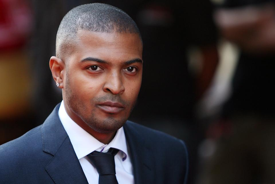 Actor and director Noel Clarke poses for photographers as he arrives for the premiere screening of his new British movie 'Adulthood',  at Leicester Square's Empire cinema, London. Tuesday, June 17, 2008. (AP Photo/Simon Dawson)