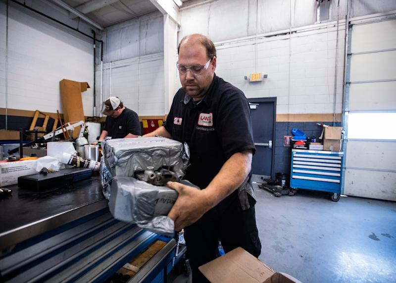 Auto technician, Mitch Lickteig works on the lifters of a 2015 GMC Sierra truck at the Landers Buick GMC in Southaven, MS Saturday, Oct. 11, 2019.