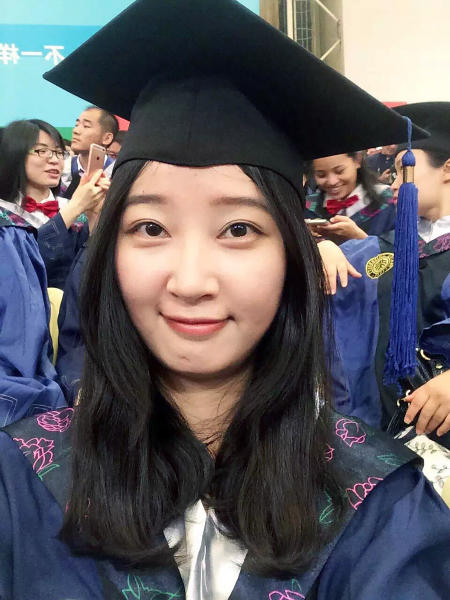 FILE - This 2016 selfie provided by her family shows Yingying Zhang in a cap and gown for her graduate degree in environmental engineering from Peking University Shenzhen Graduate School. Jurors on Monday, June 24, 2019, in Peoria, Ill., have convicted Brendt Christensen, a former University of Illinois doctoral student in the slaying of Zhang, who was abducted at a bus stop as she headed to sign an off-campus apartment lease. Zhang's body has not been found. (Zhang Family Photo via AP, File)