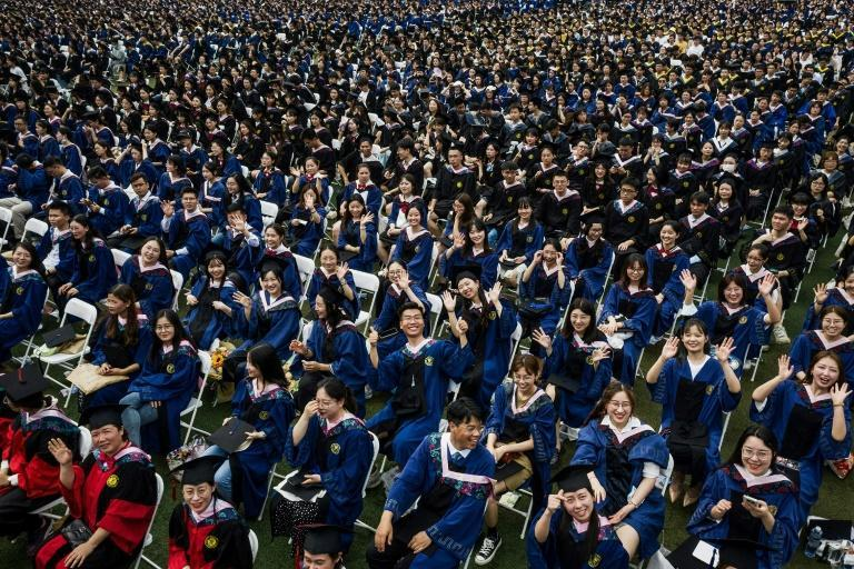 Wuhan hosted a graduation ceremony with nearly 9,000 students in attendance on Sunday, with the pandemic largely under control across China