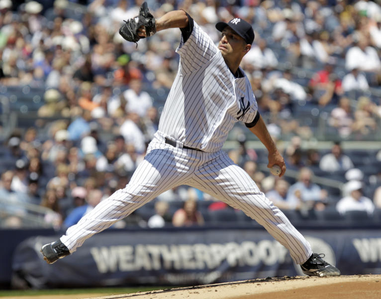 New York Yankees starting pitcher Andy Pettitte delivers during the second inning of a baseball game against the Seattle Mariners at Yankee Stadium in New York, Sunday, May 13, 2012. (AP Photo/Seth Wenig)