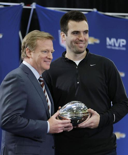 NFL Commissioner Roger Goodell poses for a photo with MVP Baltimore Ravens quarterback Joe Flacco at a news conference after the NFL Super Bowl XLVII football game Monday, Feb. 4, 2013, in New Orleans. The Ravens defeated the San Francisco 49ers 34-31. (AP Photo/Darron Cummings)
