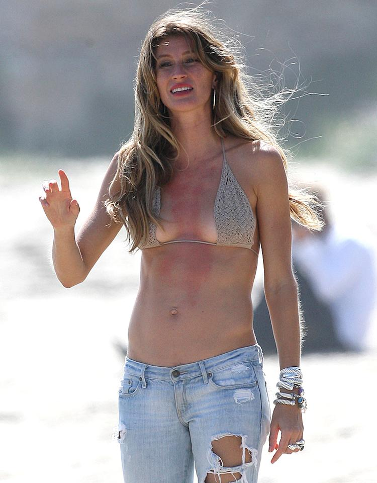 EXCLUSIVE: Gisele Bundchen filming a commercial with a beautiful black horse on the beach of Malibu. She was wearing a bikini top, some jewelry and jeans.