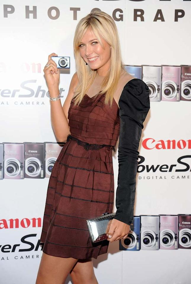 "An injured Maria Sharapova did not compete in Beijing, but the tennis queen still managed to strike a perfect pose at a promotional event in New York. Jamie McCarthy/<a href=""http://www.wireimage.com"" target=""new"">WireImage.com</a> - August 21, 2008"