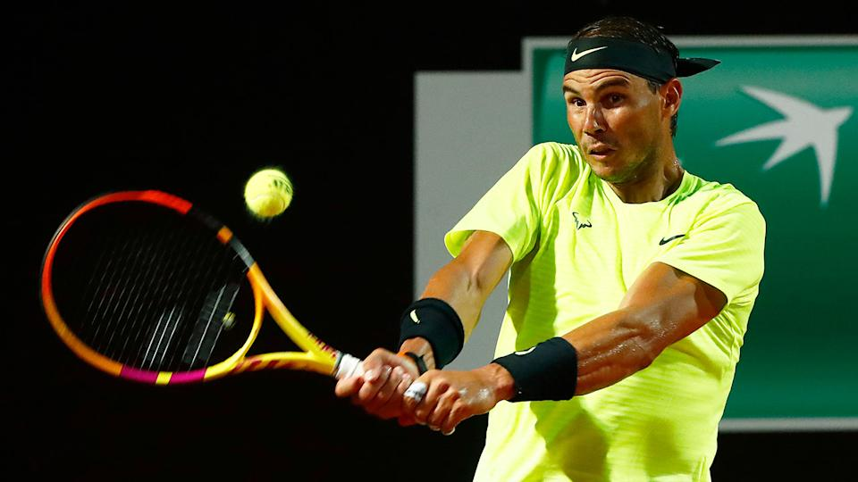Rafael Nadal is seen here hitting a backhand during an Italian Open victory.