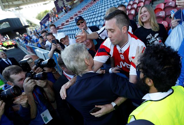 "Soccer Football - Premier League - Huddersfield Town vs Arsenal - John Smith's Stadium, Huddersfield, Britain - May 13, 2018 Arsenal manager Arsene Wenger with fans after the match Action Images via Reuters/Andrew Boyers EDITORIAL USE ONLY. No use with unauthorized audio, video, data, fixture lists, club/league logos or ""live"" services. Online in-match use limited to 75 images, no video emulation. No use in betting, games or single club/league/player publications. Please contact your account representative for further details."