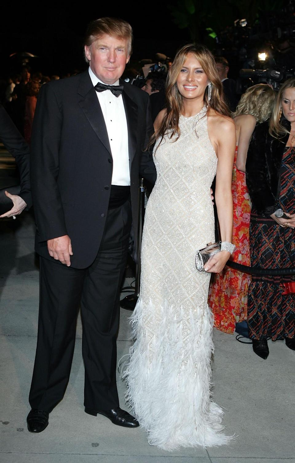 <p>For Elton John's annual Aids Ball, Melania and Donald rocked up in the perfect evening attire with the First Lady wearing a feathered silvery gown. <i>[Photo: Getty]</i> </p>