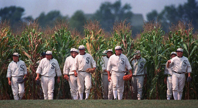 """FILE - In this July 22, 1977, file photo, people portraying ghost players emerge from a cornfield as they reenact a scene from the movie """"Field of Dreams"""" at the movie site in Dyersville, Iowa. The Chicago White Sox will play a game against the New York Yankees next August at the site in Iowa where the movie """"Field of Dreams"""" was filmed. Major League Baseball announced Thursday, Aug. 8, 2019, that the White Sox will play host to the Yankees in Dyersville, Iowa, on Aug. 13. (AP Photo/Charlie Neibergall, File)"""