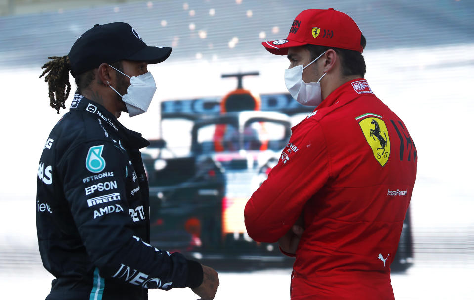 Ferrari driver Charles Leclerc of Monaco, right, speaks with Mercedes driver Lewis Hamilton of Britain after taking pole position during the qualifying session at the Baku Formula One city circuit in Baku, Azerbaijan, Saturday, June 5, 2021. The Azerbaijan Formula One Grand Prix will take place on Sunday. (Maxim Shemetov, Pool via AP)