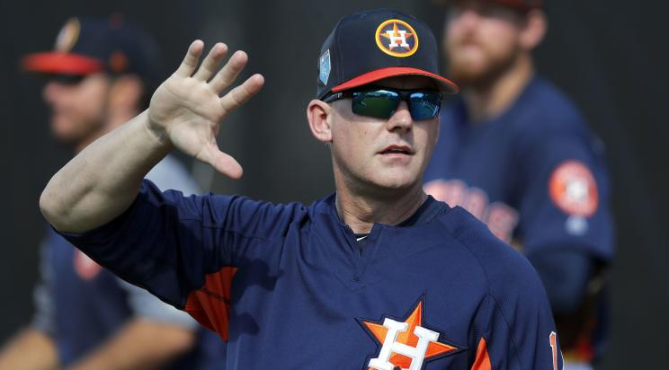 Astros manager A.J. Hinch is one of the mastermind's behind his team's four-man outfield experiment. (AP)