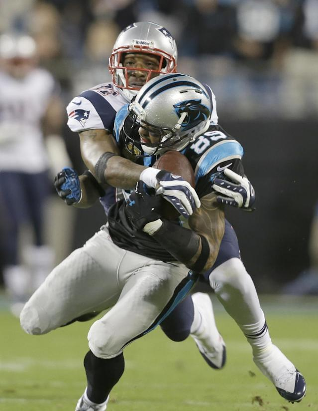 Carolina Panthers' Steve Smith, front, catches a pass as New England Patriots' Aqib Talib, rear, defends during the first half of an NFL football game in Charlotte, N.C., Monday, Nov. 18, 2013. (AP Photo/Gerry Broome)