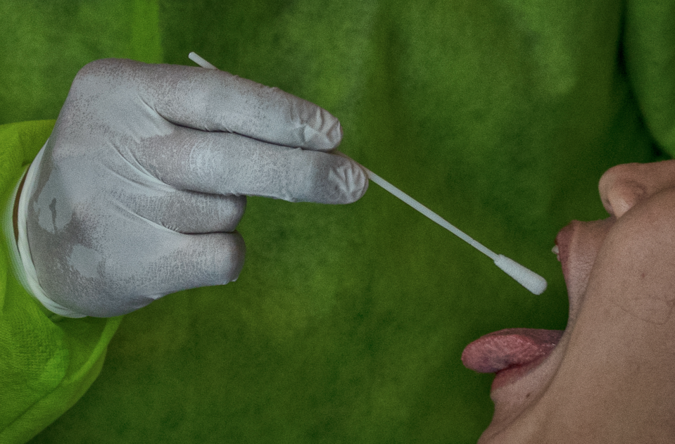 A medical personnel takes a COVID-19 swab test at Santa Ana Hospital on April 14, 2020 in Manila, Philippines. (Photo: Ezra Acayan/Getty Images)