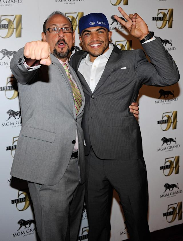 LAS VEGAS, NV - SEPTEMBER 18: Boxer Victor Ortiz (R) and his manager Rolando Arellano arrive at a post-fight party at Studio 54 inside the MGM Grand Hotel/Casino early on September 18, 2011 in Las Vegas, Nevada. Ortiz lost the WBC welterweight title to Floyd Mayweather Jr. by fourth-round knockout on September 17. (Photo by Ethan Miller/Getty Images for Studio 54)