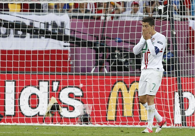 Portugal's Cristiano Ronaldo reacts after missing a chance  during the Euro 2012 soccer championship Group B match between Denmark and Portugal in Lviv, Ukraine, Wednesday, June 13, 2012. (AP Photo/Darko Vojinovic)