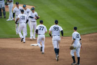 The New York Yankees celebrate their 11-4 win after a baseball game against the Miami Marlins at Yankee Stadium, Saturday, Sept. 26, 2020, in New York. (AP Photo/Corey Sipkin)