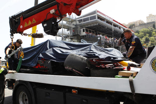 A truck lifts the car of Red Bull driver Max Verstappen of the Netherlands during the third free practice at the Monaco racetrack, in Monaco, Saturday, May 26, 2018. The Formula one race will be held on Sunday. (AP Photo/Claude Paris)