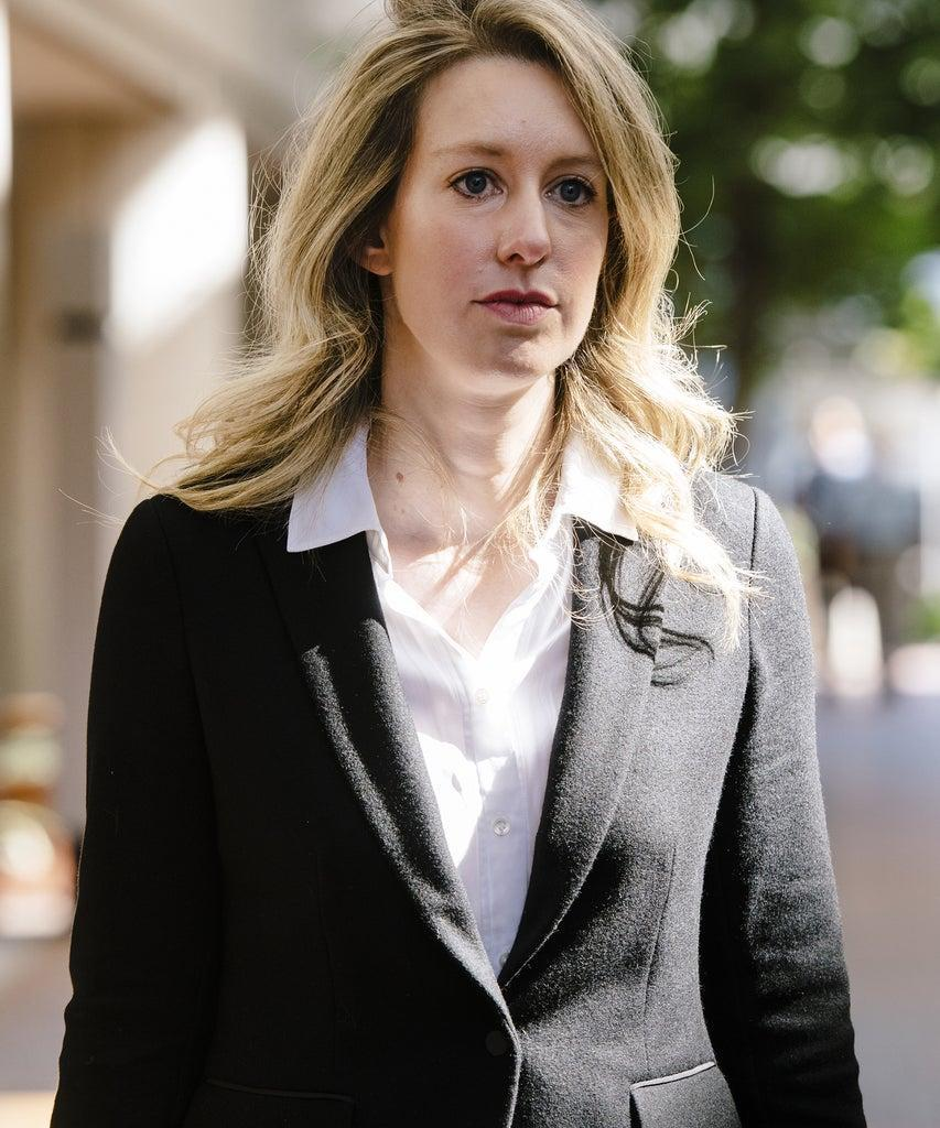 Elizabeth Holmes, founder and former chief executive officer of Theranos Inc., leaves federal court in San Jose, California, U.S., on Wednesday, Oct. 2, 2019. The defunct blood-testing startup which was once valued at as much as $9 billion unraveled amid what prosecutors describe as a massive scheme masterminded by Holmes and the company's president to mislead investors, doctors and patients. Photographer: Michael Short/Bloomberg via Getty Images
