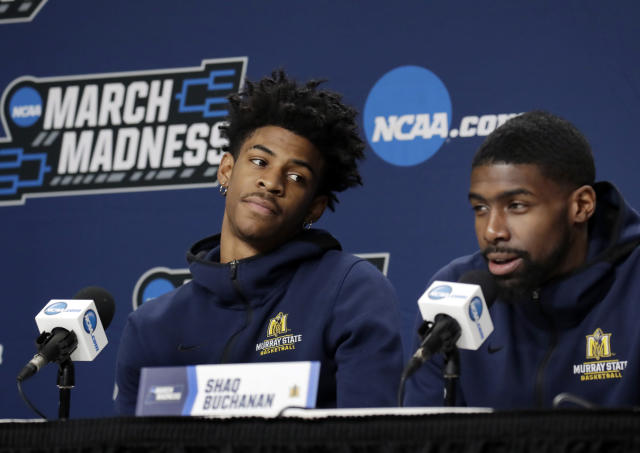 Murray State's Ja Morant, left, listens to teammate Shaq Buchanan during a news conference at the men's college basketball NCAA Tournament, Friday, March 22, 2019, in Hartford, Conn. Murray State will play Florida State in the second round on Saturday. (AP Photo/Elise Amendola)