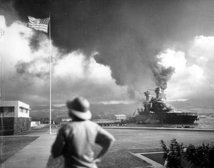 <p>The damaged battleship USS California, listing to port after being hit by Japanese aerial torpedoes and bombs, is seen off Ford Island during the attack on Pearl Harbor on Dec. 7, 1941. (U.S. Navy/National Archives/Handout via Reuters) </p>