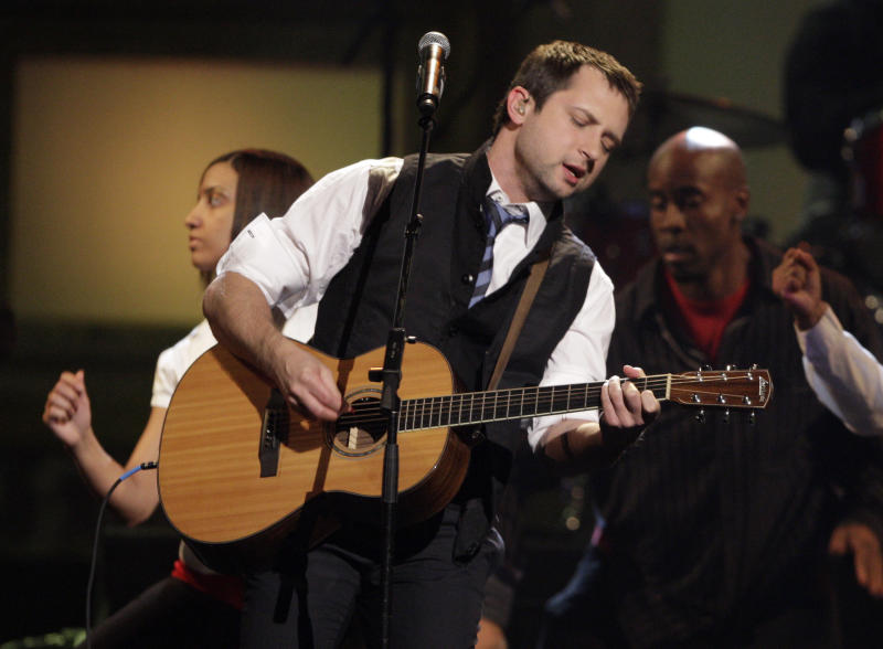 """FILE - In this April 23, 2009 file photo, Brandon Heath performs the song """"Give Me Your Eyes"""" at the Dove awards in Nashville, Tenn. Christian singer Brandon Heath doesn't need to win a Grammy on Sunday to thank his biggest supporter publicly. The 33-year old Heath is taking his former high school choir teacher, Bobby Jean Frost. Heath is up for three awards, including best contemporary Christian album for """"Leaving Eden"""" and contemporary Christian song and performance for """"Your Love.""""   (AP Photo/Mark Humphrey, File)"""