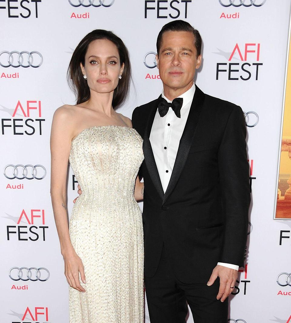"""<p>Pitt and Jolie at an event for <em>By the Sea, </em>which Jolie directed and starred in with Pitt. The movie was a critical and commercial disappointment and the event would be one of the couple's final public appearances together before Jolie filed for divorce in September 2016.</p><p>In 2017, Jolie told <a href=""""https://media.simplecast.com/episodes/audio/98863/PODCAST_ANGELINA_JOLIE_v1.mp3"""" rel=""""nofollow noopener"""" target=""""_blank"""" data-ylk=""""slk:The Hollywood Reporter's Awards Chatter"""" class=""""link rapid-noclick-resp""""><em>The Hollywood Reporter's Awards Chatter</em></a> podcast of the movie, """"I wanted us to do some serious work together. I thought it would be a good way for us to communicate. In some ways it was, and in some ways we learned some things. But there was a heaviness, probably, during that situation that carried on, and it wasn't because of the film.""""</p>"""