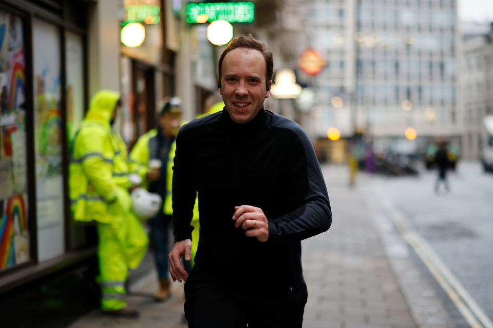 Britain's Health Secretary Matt Hancock poses running past photographers whilst out for a morning jog in Westminster central London on December 4, 2020. (Photo by Tolga Akmen / AFP) (Photo by TOLGA AKMEN/AFP via Getty Images)