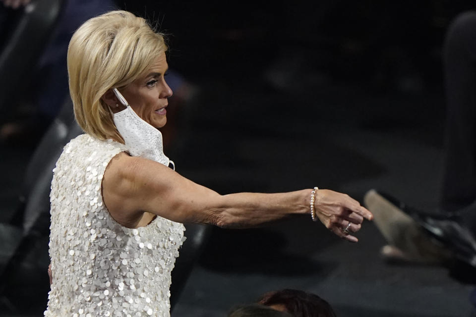 Former Baylor coach Kim Mulkey, now at LSU, points to someone in the audience at the 2020 Basketball Hall of Fame awards tip-off celebration and awards gala, Friday, May 14, 2021, in Uncasville, Conn. (AP Photo/Kathy Willens)