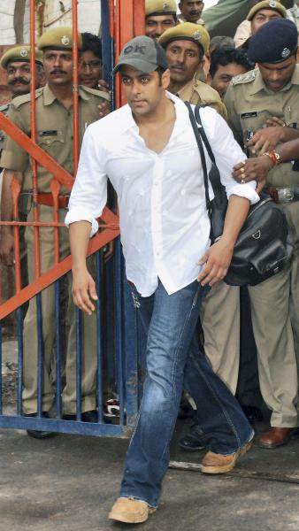 FILE- In this Aug. 31, 2007 file photo, Bollywood actor Salman Khan steps out of the Jodhpur Central Jail where he had been held for a poaching case in Jodhpur, India. An Indian judge on Thursday, Dec. 5, 2013, ordered a fresh trial against Khan on a homicide charge for a fatal road accident more than 11 years ago, and said all the witnesses would be re-examined. The pre-trial is set for Dec. 23. (AP Photo/File)
