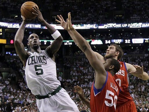 Boston Celtics forward Kevin Garnett (5) shoots against Philadelphia 76ers forward Lavoy Allen (50) and center Spencer Hawes during the second quarter of Game 7 in an NBA basketball Eastern Conference semifinal playoff series, Saturday, May 26, 2012, in Boston. (AP Photo/Elise Amendola)
