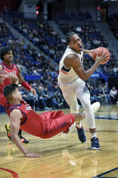 Connecticut's Brendan Adams (10) is fouled by New Jersey Institute of Technology's Diego Willis (5) in the first half of an NCAA college basketball game Sunday, Dec. 29, 2019, in Hartford, Conn. (AP Photo/Stephen Dunn)