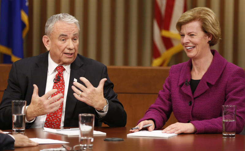 Republican candidate for Wisconsin's U.S. Senate seat, former Gov. Tommy Thompson, left participates in a debate against Democratic candidate U.S. Rep. Tammy Baldwin at Marquette University Friday, Oct. 26, 2012, in Milwaukee. (AP Photo/Jeffrey Phelps)